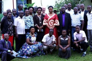Queen Agnes Ithungu(In red dress) in a group photo with KRC staff during her visit
