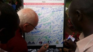Mr. Maurice Barnes signing up and committing for peace in the Region