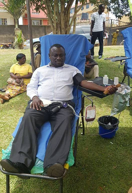 Hon Alex Ruhunda, MP Fort portal Municipality donating blood during the Health Week