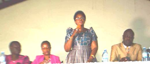 Lands State Minister, Persis Namuganza responding to citizens concerns at the Public Debate