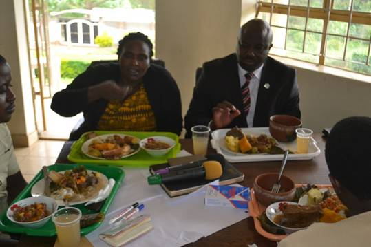 The Disitrict Chairperson, Kabarole Hon Richard Rwabuhinga and the Secretary for Production Hon Florence Kadoma sampling some of the traditional Food diets during the passing of the Ordinance